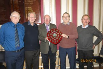 Londonderry Probus Quiz Team receiving the James Eakin Shield from Omagh President, Paul Gallagher, [centre] [L – R] James Stewart, David Burke, George Glenn and Jim Moore