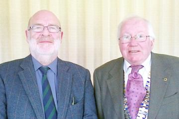 Dr McClure [left] with Probus President Paul Gallagher